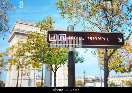 The Arc de Triomphe de l'Etoile sign in Paris, France - Stock Photo