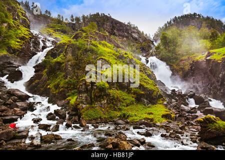 Waterfall Laatefossen in Hardanger Norway - Stock Photo