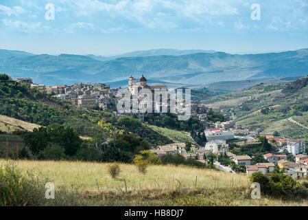 City of Petralia Sottana in front of Madonie mountain range, Sicily, Italy - Stock Photo