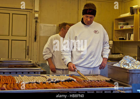 Christmas Fair Market at Ludwigsberg, Germany sausages and wurst cooking at a food booth at the annual Christmas - Stock Photo