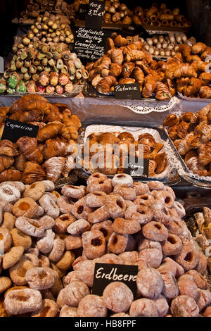 Christmas Fair Market at Ludwigsberg, Germany a booth od traditional German holiday sweets, cookies, rolls and pastries. - Stock Photo