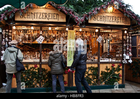 Christmas Fair Market at Ludwigsberg, Germany, a booth selling carved wooden Christmas ornaments, - Stock Photo