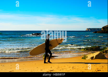 Surfer on the beach, silhouette - Stock Photo