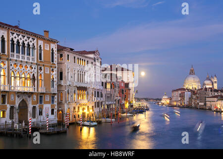 Palazzo Franchetti on Grand Canal, Venice, Italy, at dusk, with full moon. View from Academia bridge. - Stock Photo
