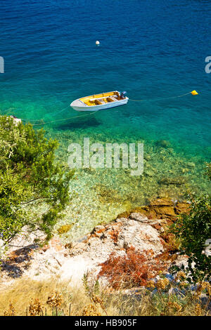 Lonely boat on idyllic beach - Stock Photo