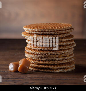 Waffles with caramel on wood - Stock Photo