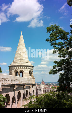 Fisherman's Bastion in the Castle Hill district, across the Danube River from Parliament House (in the distance). - Stock Photo