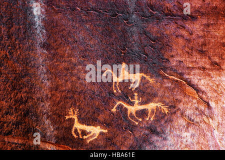 Anasazi culture petroglyph of The Hunt in Arizona's Canyon de Chelly National Monument. - Stock Photo