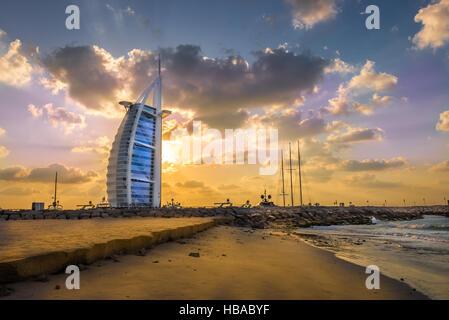 Burj Al Arab and marina at the sunset, Dubai - Stock Photo