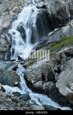 Photograph of a waterfall using the technique of long exposure. Mountain landscape of Kyrgyzstan - Stock Photo