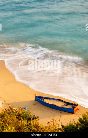 A ship stranded on the shore of a beach in Cadiz by the Strait of Gibraltar - Stock Photo