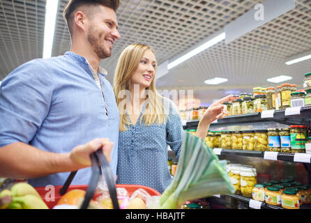 Couple shopping together in grocery store - Stock Photo