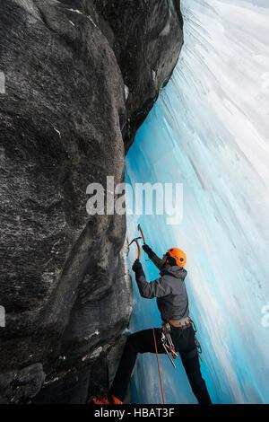 Man in cave ice climbing, Saas Fee, Switzerland - Stock Photo