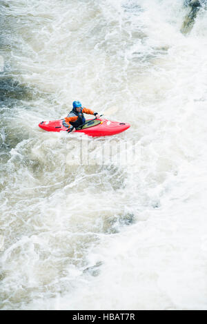 High angle view of male kayaker paddling River Dee white water rapids, Llangollen, North Wales - Stock Photo