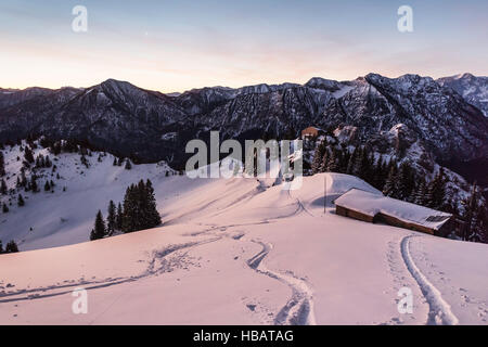 Snow tracks on Teufelstattkopf mountain at dawn, Oberammergau, Bavaria, Germany - Stock Photo