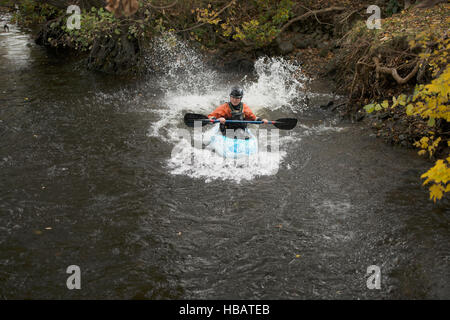 Young female kayaker paddling river Dee, Llangollen, North Wales - Stock Photo