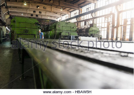 Man working on production line in tyre manufacturing plant, Ballenstedt, Germany - Stock Photo