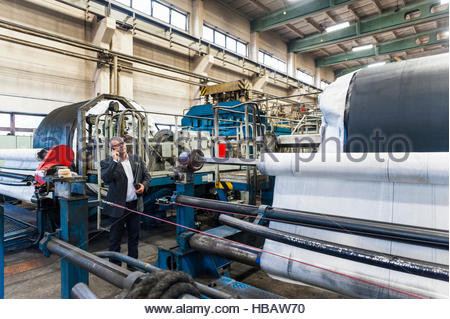 Man using mobile phone in tyre manufacturing plant, Ballenstedt, Germany - Stock Photo