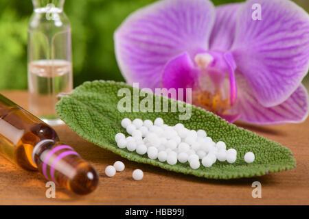 alternative medicine with homoeopathic globule - Stock Photo