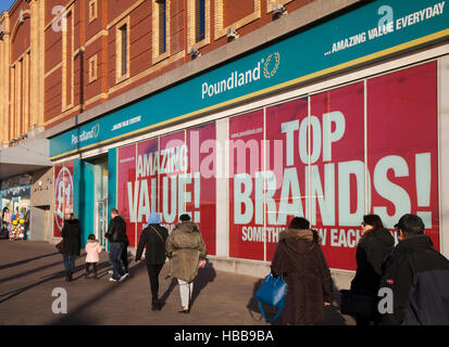 Poundland store on the Golden Mile, Blackpool seaside resort, shops and shoppers in the resort, Lancashire, UK - Stock Photo
