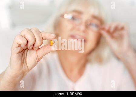 Selective focus of pill in hand - Stock Photo