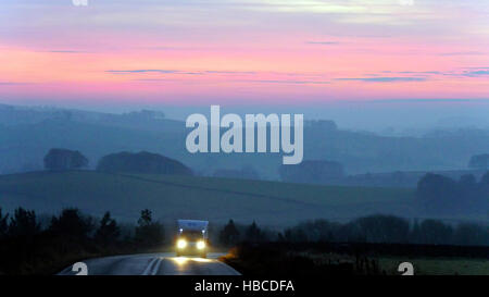 Derbyshire, UK. 5th Dec, 2016. UK Weather: amazing red sunset on a cold misty foggy evening from the A515 between - Stock Photo