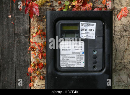 Broad Street, Oxford, United Kingdom, December 04, 2016: Oxford parking meter with Out of order notice sticker and - Stock Photo