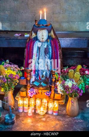 Shrine of El Maximon in Santiago De Atitlan , Guatemala. Maximon saint/devil is one of the strongest remnants of - Stock Photo