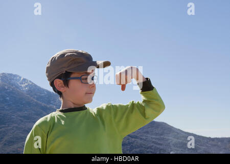 Portrait of boy flexing his muscles in Andes, Valparaiso, Chile - Stock Photo