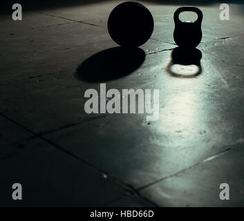 Crossfit Kettlebell weight and ball backlight and shadow - Stock Photo