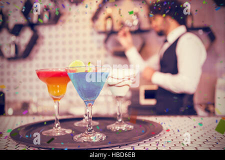 Composite image of various cocktails on serving tray in bar counter - Stock Photo