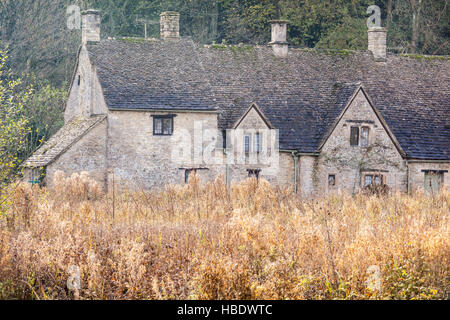 Traditional Cotswolds houses at Arlington Row in the village of Bibury. - Stock Photo