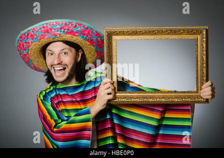 Mexican Man With Sombrero And Picture Frame Stock Photo 127541814