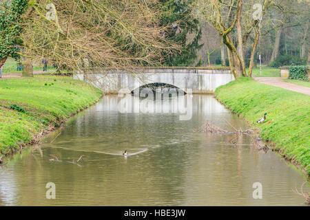 Small concrete bridge over a water jump - Stock Photo