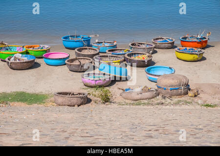 Colorful traditional boats in fishing village, Mui Ne Binh Thuan Province Vietnam Southeast Asia. Round basket boats, - Stock Photo