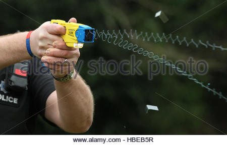 Embargoed to 0001 Tuesday December 6 File photo 26/02/13 of a police officer demonstrating the use of a Taser. Tasers - Stock Photo