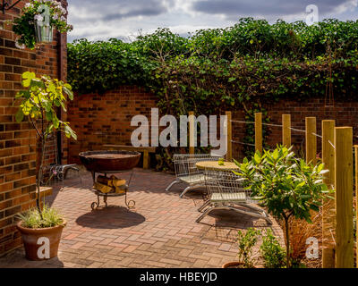 High Quality ... Garden Areas Divided Using Wooden Stakes To Create Outdoor Rooms In  Modern Contemporary Design   Stock