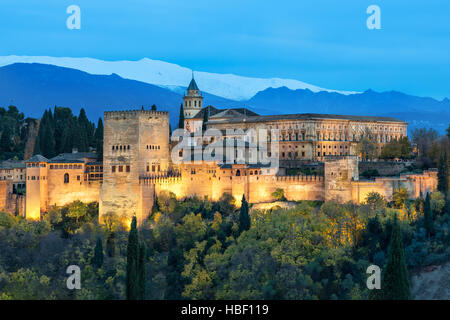 Alhambra - medieval Moorish fortress surrounded by yellow autumn trees illuminated in the evening, Granada, Andalusia, - Stock Photo