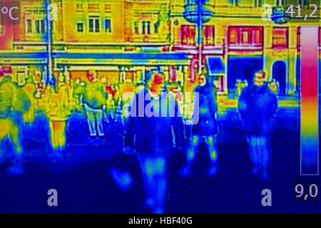 Infrared Thermal image people walking the city streets - Stock Photo