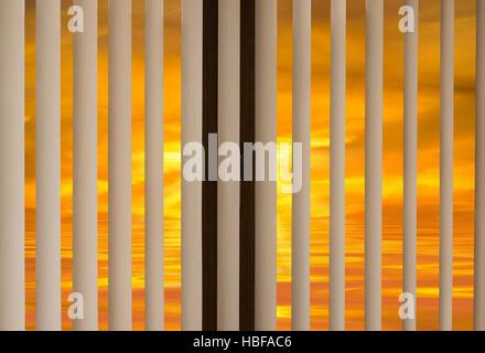 window blinds sunset - Stock Photo