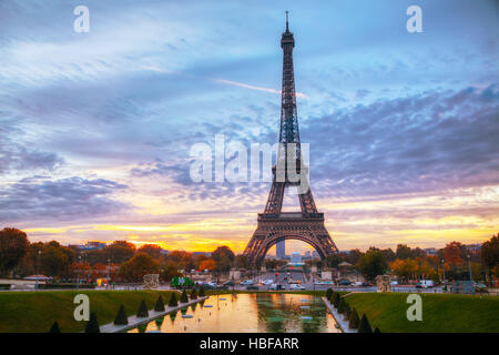 Cityscape with the Eiffel tower in Paris, France at sunrise - Stock Photo