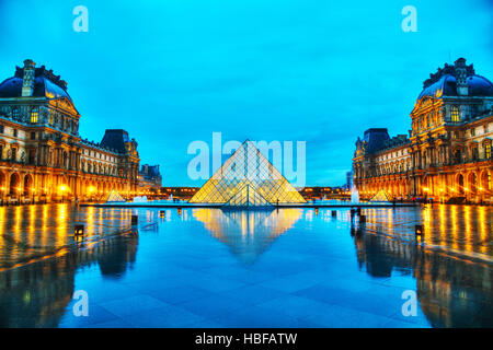 PARIS - NOVEMBER 4: The Louvre Pyramid on November 4, 2016 in Paris, France. It serves as the main entrance to the - Stock Photo