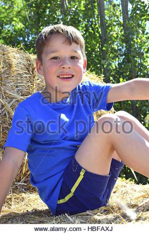 Little boy in straw - Stock Photo