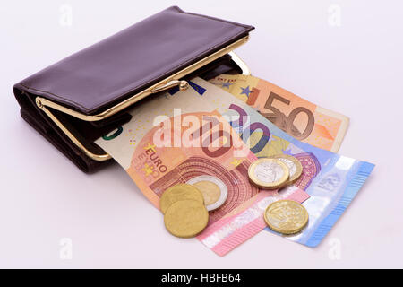 euro banknotes with coins - Stock Photo