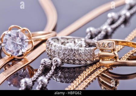 Gold, silver rings and chains - Stock Photo