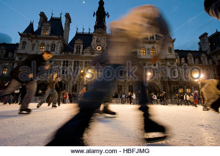 Ice skaters on a rink set up for winter in the Place de l'Hotel de Ville. - Stock Photo