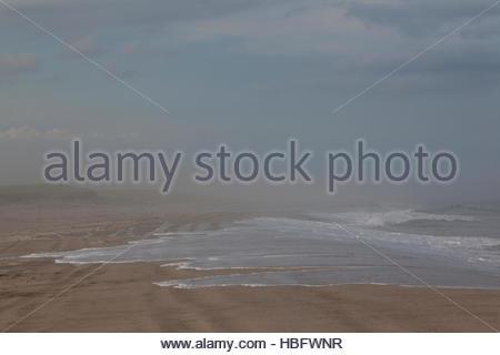 Surf spills onto Nauset Beach. - Stock Photo