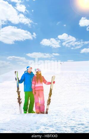 Smiling couple on a mountain - Stock Photo