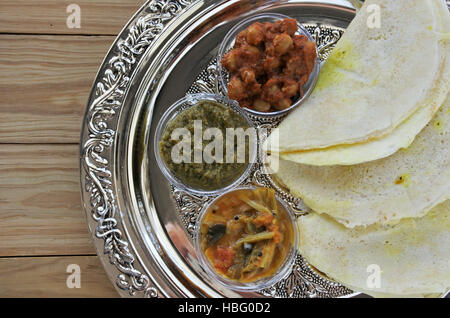 Flat lay of Indian food, Masala Dosa with Sambar and Channa Masala. Food background and texture. copy space - Stock Photo