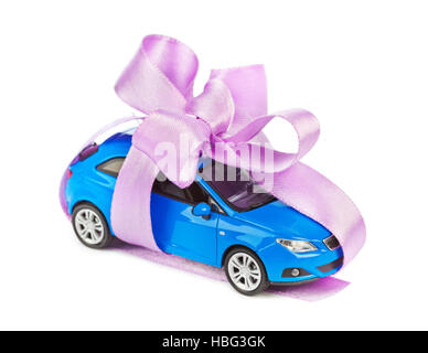 Car with bow as gift - Stock Photo